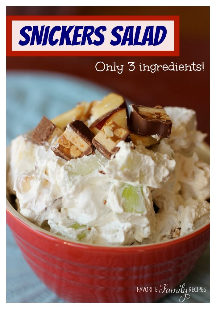 This Snickers Salad is a fun recipe! You can surprise your guests and let them guess what that chewy, caramel, nutty, deliciousness is in the salad, or garnish with extra snickers bars on top. #snickerssalad #snickersrecipe
