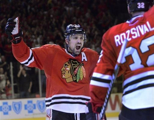 Patrick Sharp celebrates after assisting on Johnny Oduyas goal in the third period during Game 1 of an NHL hockey playoffs Western Conference semifinal in Chicago, Wednesday, May 15, 2013. The Blackhawks won 4-1. (AP Photo/Daily Herald, Bob Chwedyk)