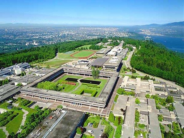 Simon Fraser University on Burnaby Mt. with Vancouver in the background.