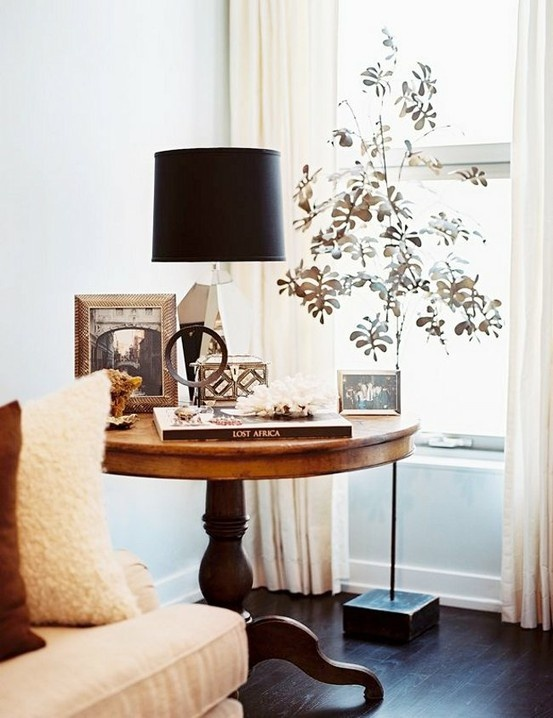 I like the idea of using a large round table in the corner that can also be used as a side table.