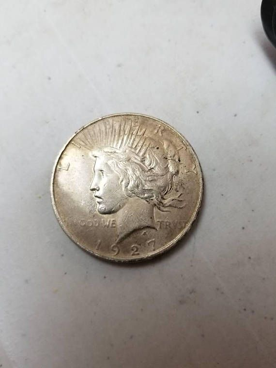 Check out this item in my Etsy shop https://www.etsy.com/listing/577632664/1927d-peace-dollar-key-date-denver-mint