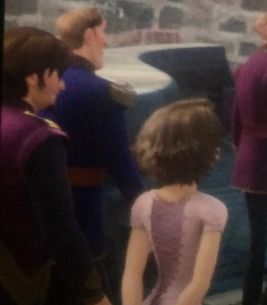 EUGENE AND RAPUNZEL IN FROZEN! THIS IS NO JOKE I SAW IT WITH MY OWN EYES!!!!! BY IT GOES BY QUICK FAST SO YOU HAVE TO LOOK QUICK. IT WAS NEAR THE BEGINNING WHEN ANNA CAME OUT OF THE CASTLE DOORS SINGING.