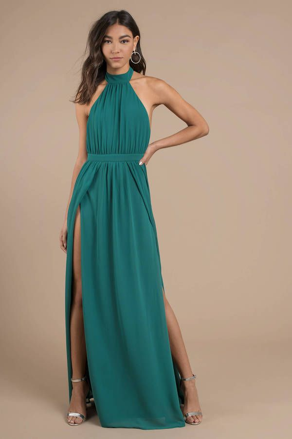 d085eb0fe13c3 Win them over with the Tara Emerald Halter Maxi Dress! Featuring a gauzy  polyester weave with a halter top and open back. The pleated empire waist  lea ...