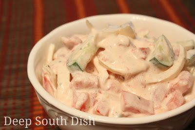Creamy Cucumber and Tomato Salad with Onion. Thick cut slices of cucumber, with sweet onion and fresh tomatoes, mixed with a mayonnaise, sour cream and fresh herb dressing for a creamy cucumber salad.
