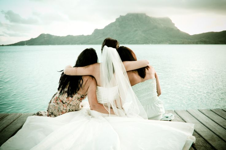 A sacred moment... a bride with her bridesmaids.