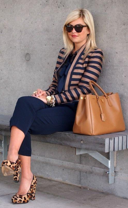 Shop this look on Lookastic:  http://lookastic.com/women/looks/sunglasses-pumps-capri-pants-bracelet-watch-tote-bag-jacket-long-sleeve-blouse/9037  — Dark Brown Leopard Sunglasses  — Tan Leopard Suede Pumps  — Navy Capri Pants  — Gold Bracelet  — Gold Watch  — Tan Leather Tote Bag  — Navy Horizontal Striped Jacket  — Navy Polka Dot Long Sleeve Blouse