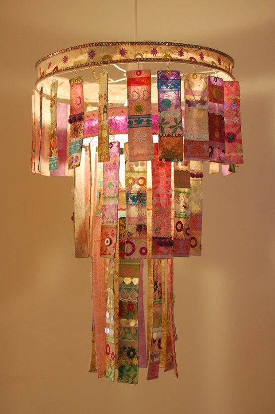 Old lamp guts and shade, wired ribbon, fabric scraps, buttons/mate-less earrings, embroidery hoops for tiers.  Cost: $10