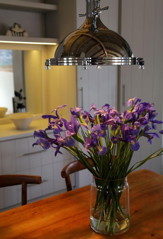 Selsey Cottage: Dining room table - Decor lighting and Iris's,   FIREFLYvillas, Hermanus, 7200 @fireflyvillas  , bookings@fireflyvillas.com,  #SelseyCottage  #FIREFLYvillas #HermanusAccommodation