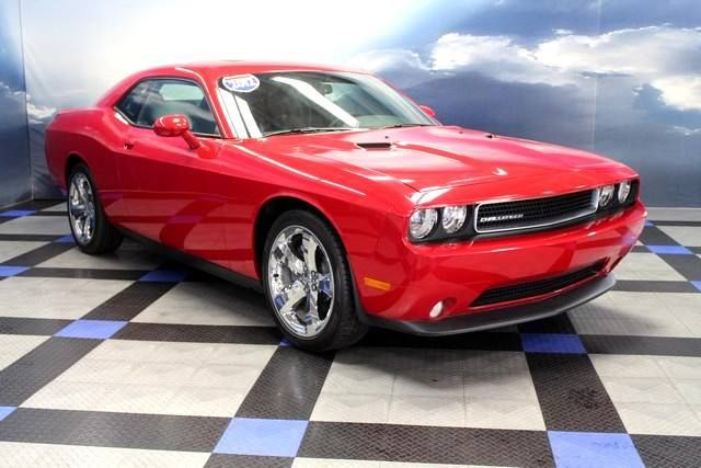 2012 Dodge Challenger Sxt With A Chili Pepper Red Exterior And A Dark Gray Leather Interior