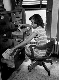 A Vintage Secretary Hard At Work Doing Filing Vintage