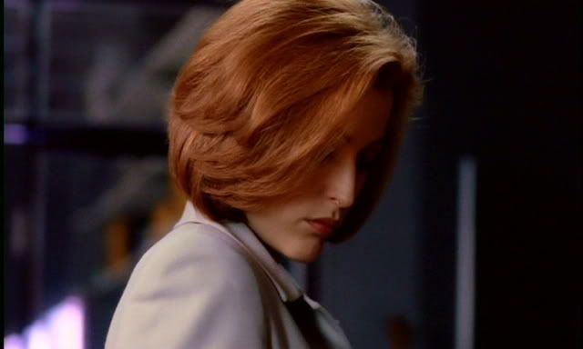 "An ""Agent Scully"" style layered bob haircut. And possibly a good henna dye job."