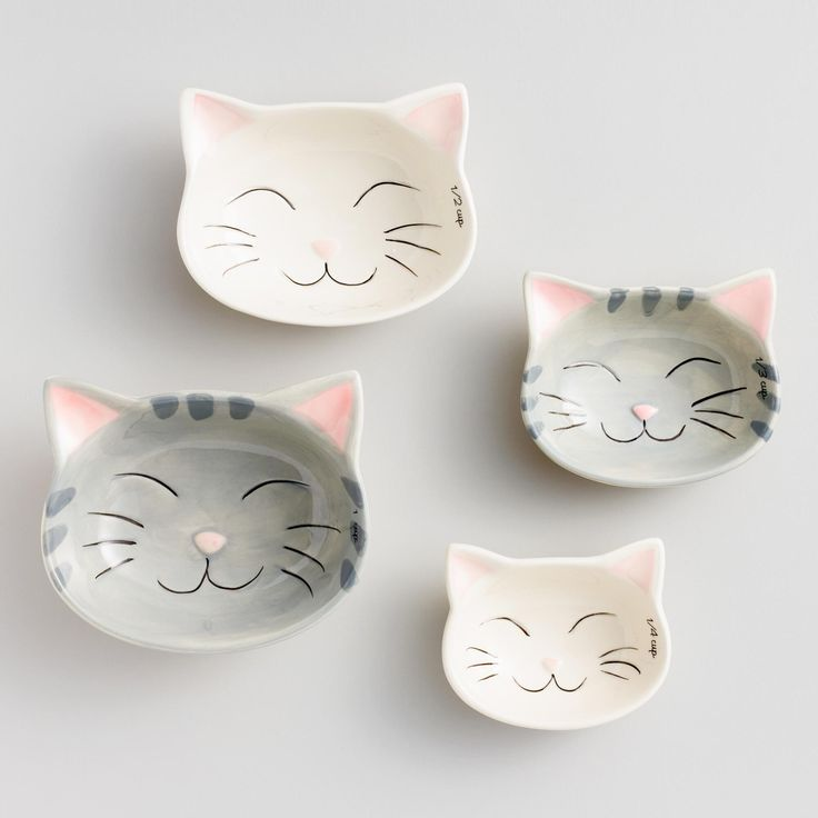 Crafted of stoneware with adorable feline details,…