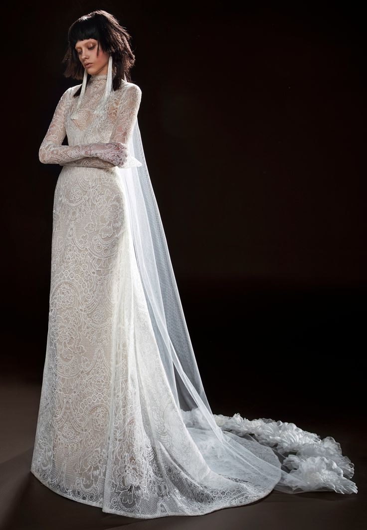 CÉCILE is a light ivory macramé lace ball gown with a draped skirt and hand placed macramé lace and bridal button accents by Vera Wang.