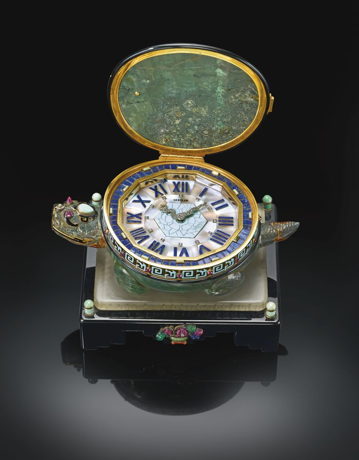[VIEW 1] CARTIER A HIGHLY IMPORTANT AND RARE GOLD, HARDSTONE, ENAMEL AND GEM-SET DESK TIMEPIECE IN THE FORM OF A TORTOISE CIRCA 1928