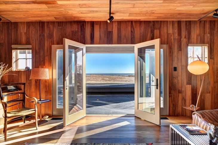 Look Inside An Art Collector S 25m Oceanfront Home In Montauk Cottages Gardens Rustic House Home Floor To Ceiling Windows
