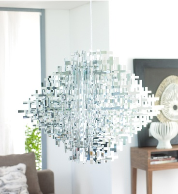 103 This innovative ceiling pendant is an amazing piece of artistic craftsmanship designed with mirrored glass, plastic and steel to radiate a gleaming, shimmering glow of reflected light. A real statement piece that would look stunning above your dining table.