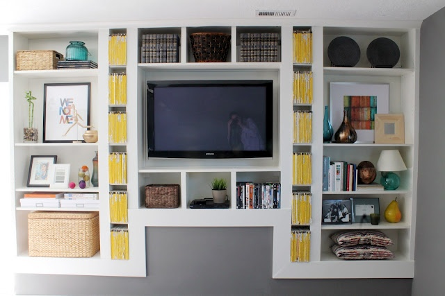 Built in shelving from iKEA billy bookcases and molding!