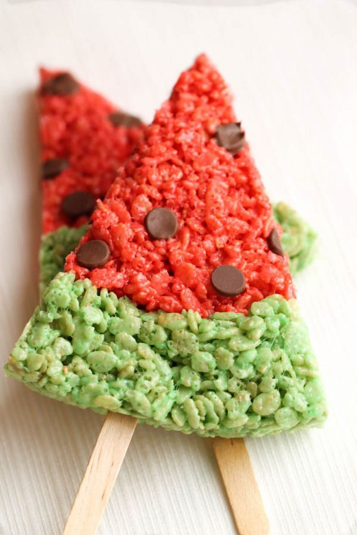 Watermelon Rice Krispie Treats - Six Sisters' Stuff   These cute watermelon slices are sure to be a hit with the kids. They are the perfect dessert for a party! #kidspartyideas #snacks #partyfood #sixsistersrecipes