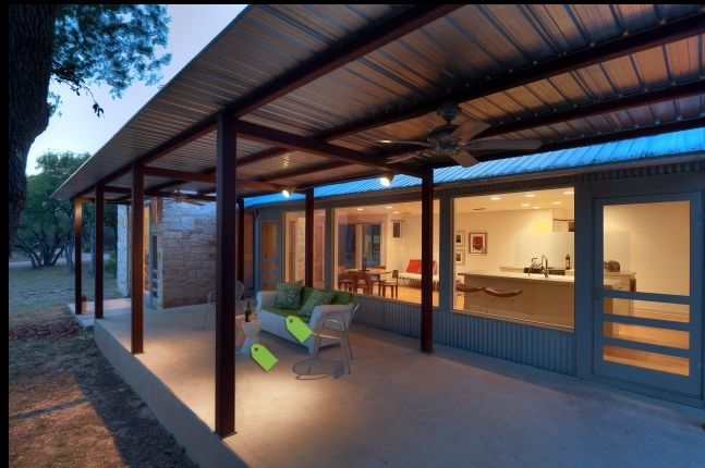 Concrete patio with metal pergola and roof
