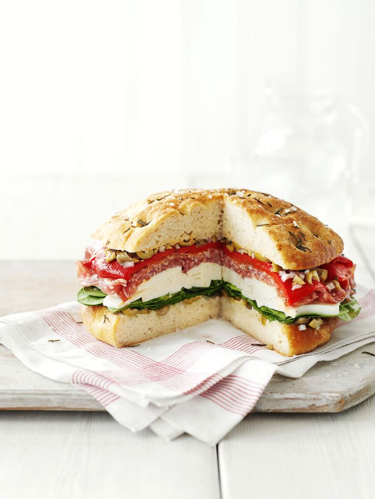Italian picnic loaf - a fantastic easy-to-make recipe using a ciabatta bread mix, baked then stuffed with an olive salad, salami, roasted red peppers, mozzarella and spinach. Wrap in foil and slice to serve.