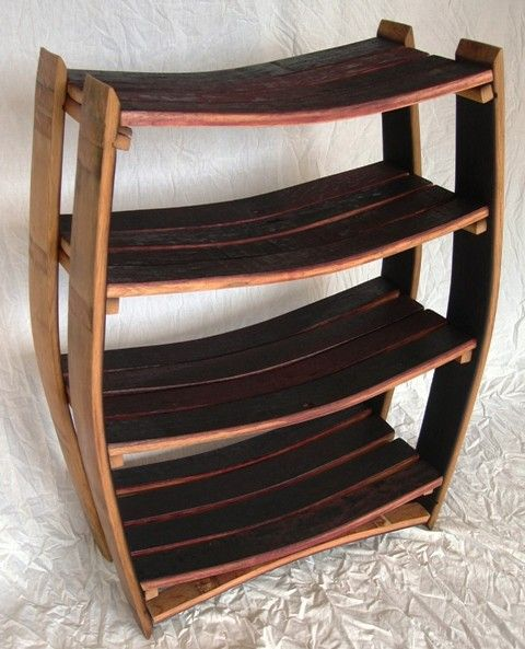 Funky, cool bookcase from wiskey/wine barrel staves! Wine Barrel Bookcase  Regular  100 by winecountrycraftsman on Etsy, $275.00