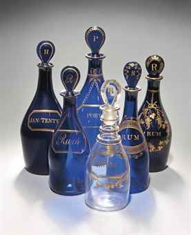 FIVE ENGLISH BLUE-GLASS DECANTERS AND STOPPERS AND A CLEAR-GLASS EXAMPLE CIRCA 1800