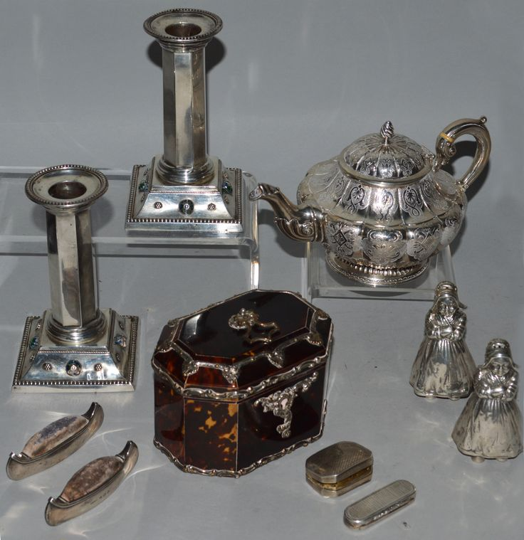 A representation of fine silver to be included in the auction. Various estimates.