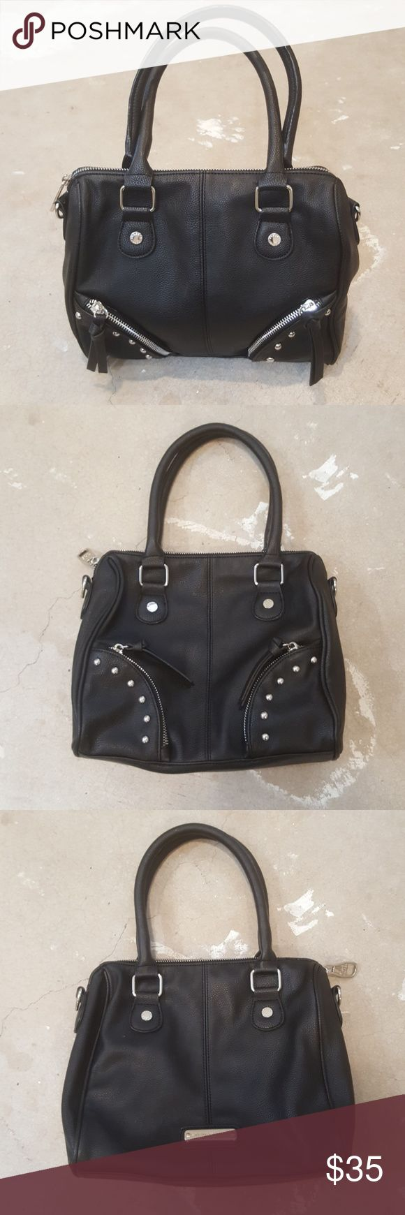 """Small Steve Madden Black Tote Bag I am selling a chic and simple Steve Madden Tote.  This is a small size and works perfectly as a """"night out tote"""".  I love the black and silver color combo and the small stud embellishments on the front of this bag.  It is in overall excellent condition with minimal wear here and there, no rips or stains. I do not have the long crossbody strap as I always carried on my forearm.  This silhouette is quite popular among fashion bloggers, scoop up and be on…"""