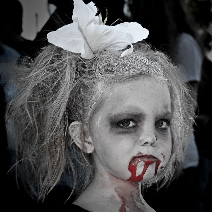 Jeremy said were being a family of Zombies for halloween! lol this make up is cute, in a disturbing way...