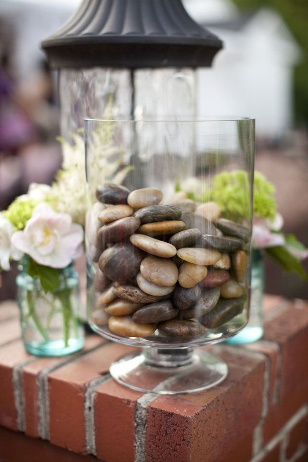 Love this idea! Each guest holds a stone during the ceremony, make a wish for the couple and then drops it in the jar at the end of the ceremony.