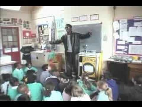 "roots manuva -  witness the  fitness    In 1982 Rodney ""Roots"" Manuva attended Woodmansterne Primary School in Streatham, South London. He came last in every event."