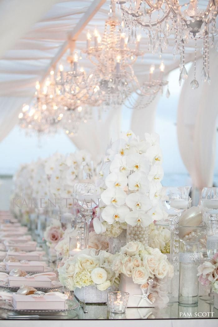 such a glamorous outdoor beach wedding reception idea; click to see more gorgeous white color wedding ideas; photo: Pam Scott
