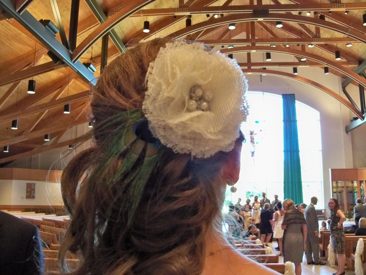 My mom made fabric flowers out of recycled lace, fabric or even wedding dresses. Here is a hair flower with peacock feather attached for the bridesmaids and readers!