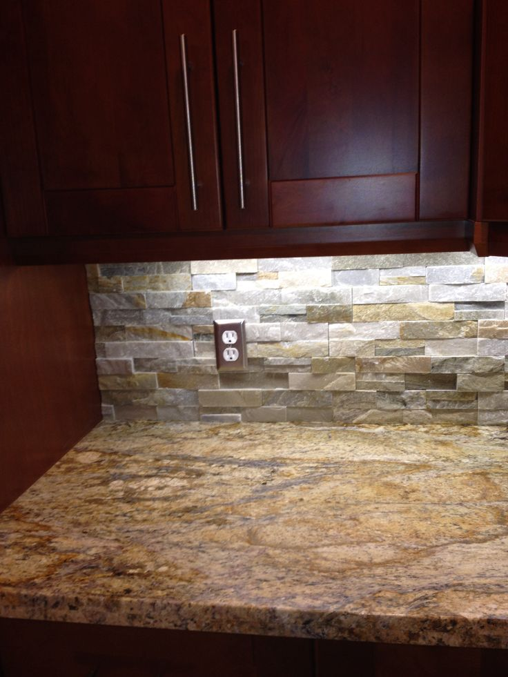 Yellow river granite and quartz ledgestone backsplash Backsplash ideas quartz countertops