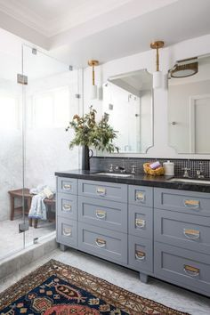 Duncan's bathroom with one vanity. Like the look of the blue with golds