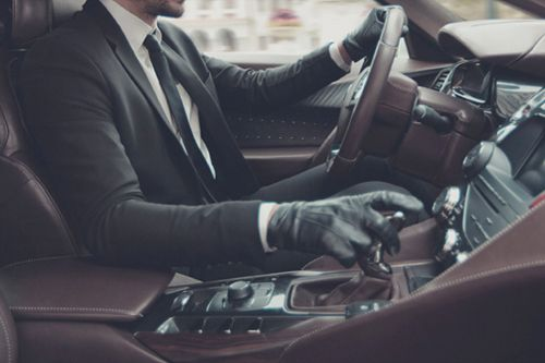 The only time that a man is allowed to wear leather driving gloves. Driving a fine European automobile. Or strangling somebody from behind with piano wire.
