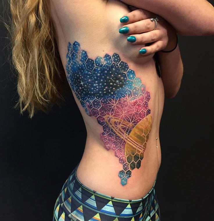 Geometric space tattoo including the planet Saturn by Nick Friederich. http://tattooideas247.com/saturn-space-tattoo/