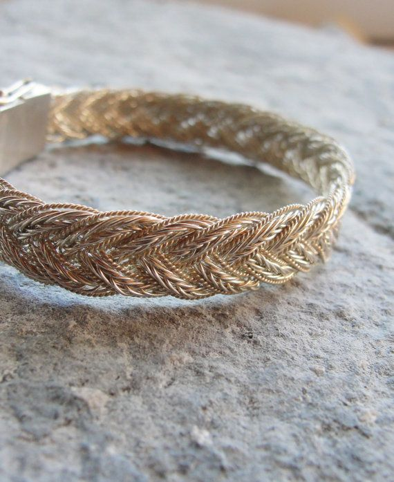 This amazingly chic bracelet is handmade out of sterling silver (925 and 950) made with two special braiding techniques. The bracelet is hand woven