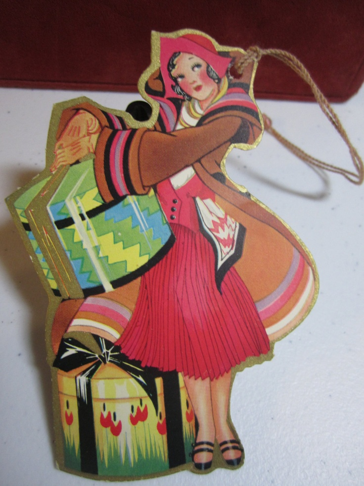 Art Deco 1920's-30's gold gilded die cut unused easter bridge tally card deco bobbed hair lady in colorful outfit holding a deco hat box.  via Etsy.