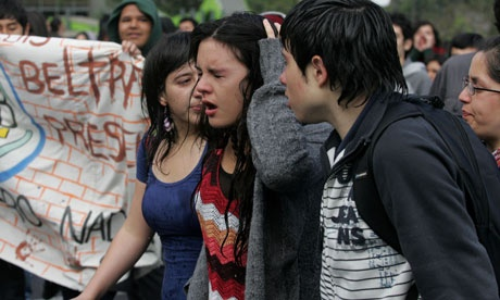Camila Vallejo feels the effects of a water cannon-soaking during a protest in Santiago last October. Photograph: Cristobal Saavedra/Reuters