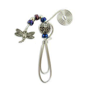 The bookmark is made of wire with indigo coloured beads and hanging dragonfly charm. Very stylish wire and bead bookmark which easily clips onto the page.