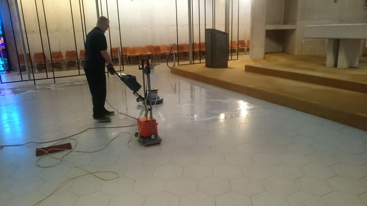Cleaning a Terrazzo Floor in a Bristol Cathedral. Removing marks from plastic film which has stained the surface