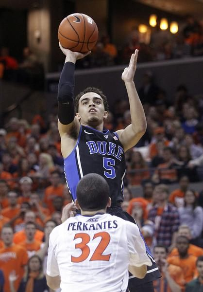 Duke guard Tyus Jones (5) shoots over Virginia guard London Perrantes (32) during the first half of an NCAA college basketball game in Charlottesville, Va., ...