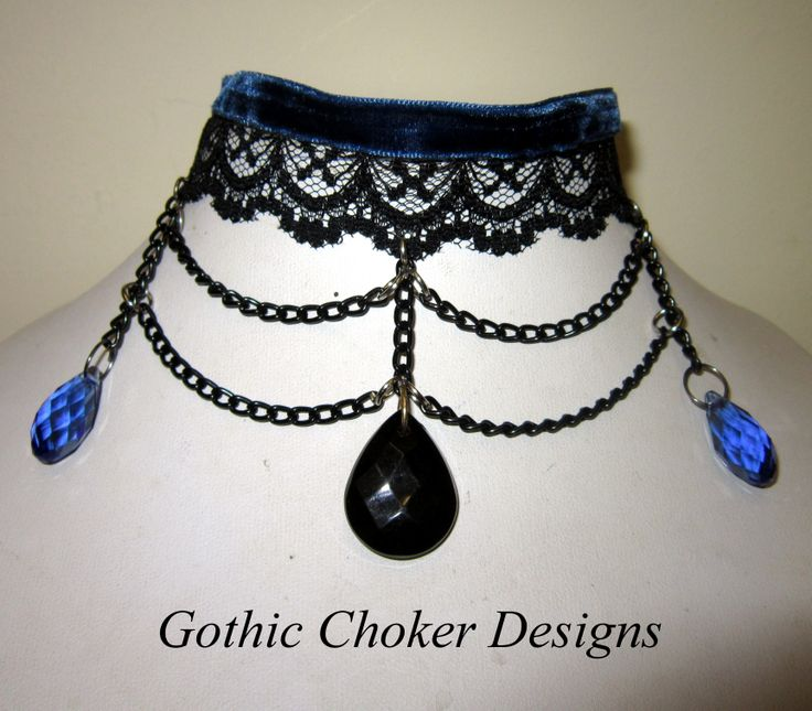 Blue velvet and black lace choker with black acrylic crystal and blue glass crystals suspended by black chains. R160 approx $16 Purchase here: https://hellopretty.co.za/gothic-choker-designs/blue-and-black-choker-with-chains-and-crystals