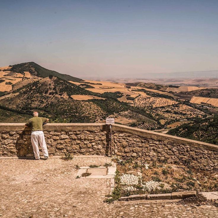 Photo by @petekmuller. Carlo, a retired barber, looks out over the agricultural fields of #Bovino, Italy. To occupy his time, he makes wine, cheese and other traditional foods and runs a small space devoted to the preservation of history and culture in this tiny mountain village. Expecting no payment, he took us on a guided tour of Bovino's historic districts, telling stories going back to the pre-Roman period--tales of bandits, agricultural development, counterfeit money, and illicit…