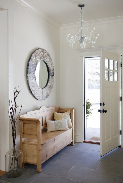 bright, white, love the blue stone floor, and wood bench and mirror. Same front door as ours, so of course I love it too!