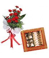 Wonderful rose bouquet with 500 gm assorted sweets can make a special happiness. You can order it from FlowerzNCakez.