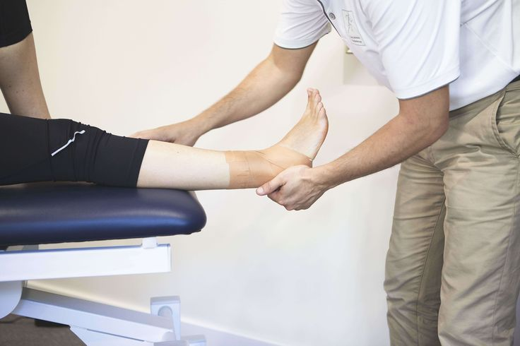 Using tape to strap an ankle can prevent ankle strain injuries