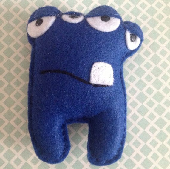 Humphrey the small blue plush felt monster toy, pin cushion, brooch, party filler. via Etsy