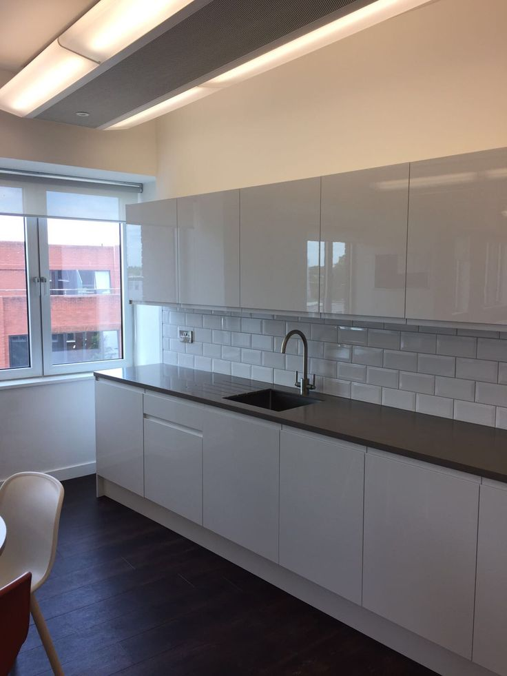 Recent installation of Howdens Clerkenwell gloss white kitchen range installed into commercial office.